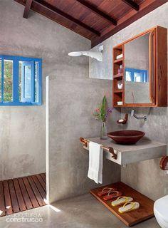 Banheiro - cimento queimado e madeira.