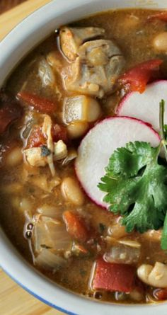 Slow Cooker White Chicken Chili ~ Full of tender chicken thighs, white beans and just enough spice to give it some zest!