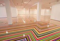 Jim Lambie, Zobop, 2014, vinyl tape, varnish, dimensions variable. Installation view of the 19th Biennale of Sydney (2014) at the Museum of Contemporary Art