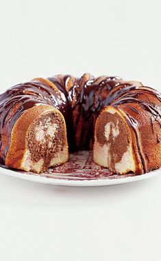 Neapolitan Bundt Cake: This cake originally ran as part of a Betty Crocker cake mix ad campaign in the 1970s, offering the flavors of Neapolitan ice cream: vanilla, chocolate, and strawberry. We tweaked the recipe to accommodate a homemade cake and boosted the chocolate and strawberry flavors as well. Now this is a cake worth revisiting. Strawberry Muffins, Strawberry Desserts, Baking Recipes, Cake Recipes, Dessert Recipes, Neapolitan Ice Cream, Cupcake Pictures, American Cake, Tea Time Snacks