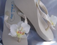2ebb14cb787f8 Items similar to Ivory Flip Flops or White Flip Flops with Pearls and  Rhinestones Beach Wedding Sandals Ivory Bridal Sandals Ivory Wedding Sandals  on Etsy