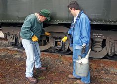 May 6, 2010 - Train crew check a coach's wheel bearings to make sure they're oiled.