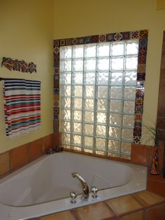 """Mexican tiles and some Command velcro strips create a """"framed"""" bathroom window that can easily be removed in the future with no wall damage."""