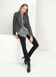 Blouse Elégance Paris, craquez sur la Blouse noir/blanc Elégance de la Boutique Elegance Paris prix 199,00 € TTC.