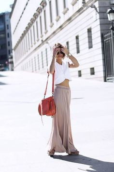 Nude maxi skirt and white crop top.  Perfect neutral colored outfit for the hot weather. Get the look with a nude khaki maxi skirt only $17.99.