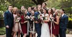 Love these wedding colors! Dark red and pink, mixed with blues and golds. Mismatching bridesmaids dresses are awesome!