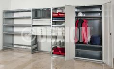 HI280 industrial warehouse shelving showing just some of the accessories that are available, such as Drawers, garment hanging rails, doors and dividers.