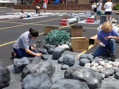 Painting paper mache rocks and boulders