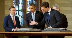 President Barack Obama (center) views the Act of Abjuration, widely considered to be the source document for the U.S. Declaration of Independence, during a tour of the Rijksmuseum with Museum Director Wim Pijbes (left), Prime Minister of the Netherlands Mark Rutte (right) and Mayor of Amsterdam Eberhard van der Laan (back right) in Amsterdam on March 24.