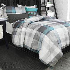 Bring easy going style to your bedroom with the Sawyer Duvet Cover Set. Decked out in a classic plaid pattern in grey, white and turquoise hues, the trendy bedding instantly adds a cool, fresh look to any room