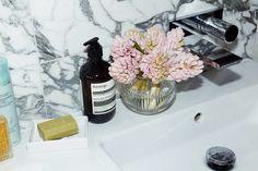 Gray marble walls + minimalist bath hardware.