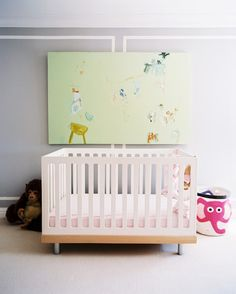 Lonny Mag featured this gray modern nursery with a pop of pink from a 3 Sprouts Elephant Stroage Bin available at Makaboo.com
