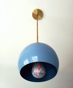 The Large Loa Pendant with a Hydrangea Blue Shade shade is a simple, globe shaped pendant available with multiple metal finishes to suit any design style. Each pendant comes with three downrod options: 24 inches, 18 inches, and 12 inches. Modern Lighting Design, Modern Farmhouse Design, Blue Hydrangea, Globe Pendant, Colorful Decor, Pendant Lighting, Interior Decorating, Ceiling Lights, Island Lighting