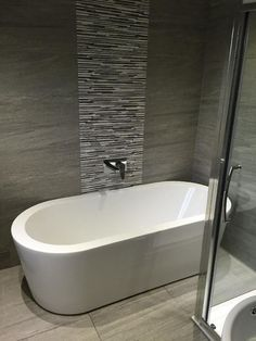 The Arc freestanding bath looks beautiful against the grey tiles in this bathroom belonging to Jason in Newcastle Upon Tyne Eyebrow Makeup Tips Grey Bathroom Wall Tiles, Bathroom Tile Designs, Grey Tiles, Bathroom Layout, Bathroom Interior, Modern Bathroom, Bathroom Ideas, Bathroom Photos, Bathroom Cabinets