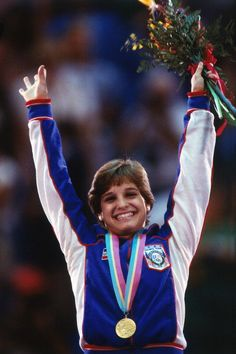 1984 Summer Olympics Closeup of USA Mary Lou Retton victorious with gold medal after winning Women's AllAround competition at Pauley Pavilion Los...