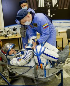 https://flic.kr/p/v1Z77C | jsc2015e071595 | In the Integration Facility at the Baikonur Cosmodrome in Kazakhstan, Expedition 44 crew member Kjell Lindgren of NASA undergoes a pressure and leak check of his Sokol launch and entry suit July 11 as part of a fit check dress rehearsal. Lindgren, Oleg Kononenko of the Russian Federal Space Agency (Roscosmos) and Kimiya Yui of the Japan Aerospace Exploration Agency will launch July 23, Kazakh time from Baikonur in their Soyuz TMA-17M spacecraft…