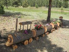 Log Train Planter with Flowers - very cute. a small - very small version for faery garden?