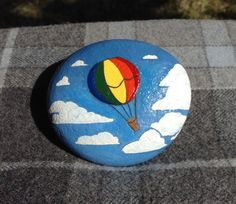 Hand Painted Rock Sailing through the clouds by AfterHourArt