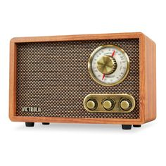 Listen to your favorite tunes with the Victrola Wood Bluetooth FM/AM Radio. It features a timeless design and will have you listening to music from traditional analog with AM/FM tuning dial, built-in speakers while you enjoy the treble controls feature. Retro Radios, Rotary, Pocket Radio, Westerns, Built In Speakers, Stereo Speakers, Bluetooth Speakers, Thing 1, Vintage Records