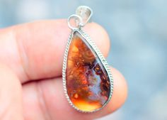 "A fire agate pendant Mexican mine ""La Negrita"" sterling silver bezel mountedTotal size, 32x16x8 mm.Total weight 21.5 carats"