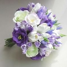 Beautiful bouquet with freesias, white tulips, violet eustoma and roses. All the flowers and each stamen is made by hand from air dry polymer clay. Diameter Height Bouquet is very light gramm), all flowers are flexible. PLEASE, read full information about Tulip Wedding, Purple Wedding Bouquets, Rose Wedding Bouquet, Bride Bouquets, Wedding Flowers, Bridesmaid Bouquets, Wedding White, White Bridal, Wedding Bridesmaids