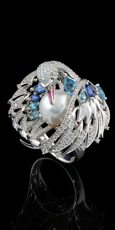 A true masterpiece this Swan Ring in 18k white gold, white sea pearl, diamonds, blue sapphires and topaz emamel from Birds of Paradise Collection @}-,-;---