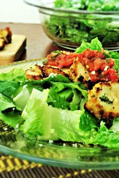 Chicken Parmesan Salad with Fresh Tomato Sauce: A unique spin on a heavy fried dish. This chicken is crispy and light and tossed with a warm fresh tomato sauce over greens.
