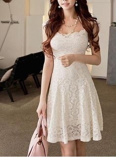 You have never looked lovelier than you will look in this pretty lace mini dress. It is presented in a fully-lined, ivory lace that is intricately latched and perfect for this particular feminine desi