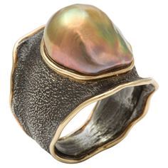 Marilyn Cooperman Pearl Ring, Wonderful Patinated Silver & South Sea Pearl Ring edged in 18kt Yellow Gold. Yellow Pearl Assymetrically set in ruffled & hammered mount . Signed 750 & 925 & initialed MFC. United States, 2008.