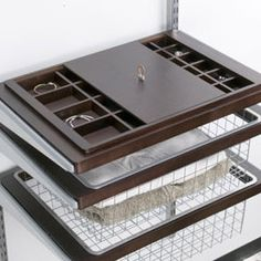 Walnut elfa décor Jewelry & Accessory System.  This jewelry tray is wonderful.  You can order 2 lids so that it remains dust free.