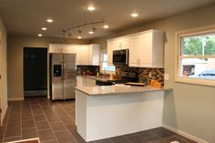 Our white cabinets again with a different backsplash and beautiful gray tile!