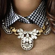 Necklace, blue gingham, tan sweater. Yes love chunky glam collars on a masculine look.