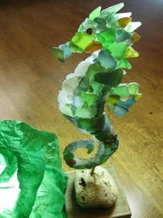 Well, the site doesn't say how or with what, but it does look like it's done with sea glass and wouldn't it be cool to try to do this?!