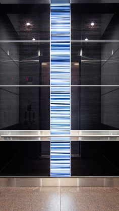 Our LEVELe-107 Elevator Interiors bring a contemporary twist to this property. The illuminated LightPlane Panel with custom blue stripes adds visual height and produces an instant focal point. The colorful accent pops against the minimalist interior and creates an energetic dynamic.