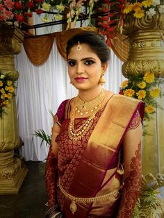 Traditional Southern Indian bride wearing bridal silk saree and jewellery. Reception look. Makeup and hairstyle by Swank Studio. #BridalSareeBlouse #SariBlouseDesign #BridalMehndi #henna Find us at https://www.facebook.com/SwankStudioBangalore
