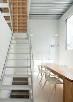 Tokyo studio Ryuji Fujimura Architects designed the residence, which is enclosed behind a grey powder-coated steel facade.