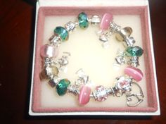 Pink & Dark GreenAuthentic  Pandora by Lulujewelrytreasures, $89.99. Beautiful in Green and Pink. One of A Kind. Great Price. Hugs, Lulu