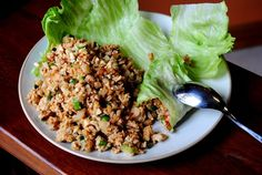 i simply HAVE to make these lettuce wraps.. but who will bring me a frou-frou asian-inspired cocktail to go with?