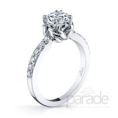 from Parade DesignA feminine flourish presents a brilliant diamond in this simple and chic Hemera engagement ring.