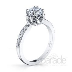 from Parade DesignA feminine flourish presents a brilliant diamond in this simple and chic Hemera engagement ring.