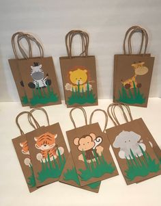 These adorable Safari favor bags are a special addition to your safari themed party They are great for candy table decoration, and they make special thank you party favor. 12 Goodie Bags of each character) Bags are (without handles) X W Safari Theme Birthday, Jungle Theme Parties, Wild One Birthday Party, Safari Birthday Party, Animal Birthday, 1st Birthday Parties, Party Themes, Themed Parties, Safari Party Favors