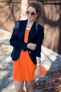 Orange dress and dark blue blazer
