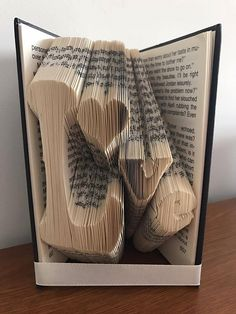 http://bookfoldingart.co.uk/product/love-sloping-valentine-mmf-book-folding-pattern/