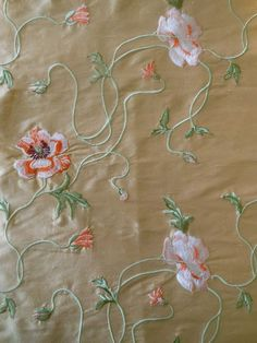 Beautiful length of vintage embroidered silk. I adore the stylized Art Nouveau type poppy floral. Shades of tangerine, an eggplant, peach and soft pink on a rich tan ground that has a bit of a rose shimmer as well when it hits the light.