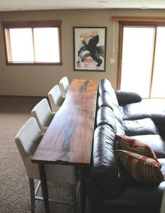 No room for a dining table? No problem! A skinny table behind a couch will save you space while allowing you catch up on your favorite shows.