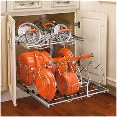Two-Tier Cookware Organizer - No More Running in Search of Pans! - http://www.amazinginteriordesign.com/two-tier-cookware-organizer-no-more-running-in-search-of-pans/