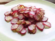 "Crispy Baked Radish Chips (Low Fat/Low Carb) - DID THIS WITH EGGPLANT AND IT WAS YUMMY   DAIKON RADISH WOULD BE NICE TOO. ALMOST ANY VEGIE, JUST SALT THE ""WET"" ONES TO BRING OUT THE WATER"