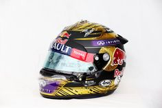 2013 German Grand Prix: This design incorporates the colours of the German flag for Sebastian's home grand prix. The combination of highly sparkling glimmer lacquer and matte black, makes for a striking contrast.