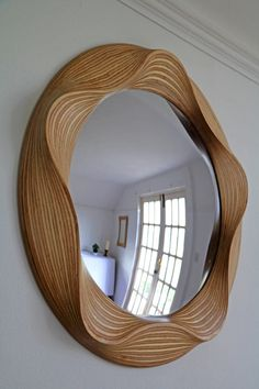 Convex wooden mirror carved from one solid piece of Birch Introducing the contemporary wooden AURA mirror with convex mirror glass. This beautiful piece is carved from one solid piece of birch and combines the classic look of a convex mirror with a con. Round Wooden Mirror, Wood Framed Mirror, Round Wall Mirror, Round Mirrors, Mirror Glass, Mirror Bathroom, Wood Tea Light Holder, Spiegel Design, 3d Cnc