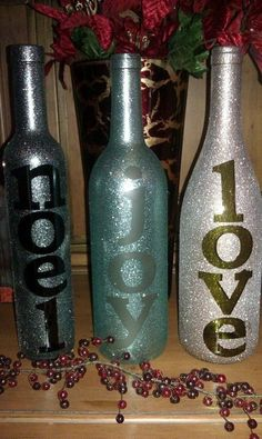 Christmas Decorations from wine bottles - Just stick-on letters, use glittery spray paint, peel off letters. You can add lights inside by M...